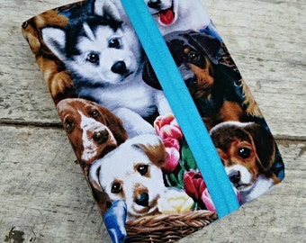 NWT reversible Bible cover, Dogs and flowers, regular sized. Gray and white houndstooth print on reverse. Tulips and puppies in baskets.