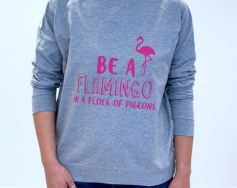 Be A Flamingo In A Flock Of Pigeons Sweatshirt - Women's Sweatshirt