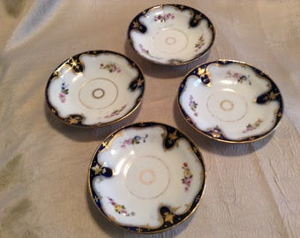 Set of 4 Flow Blue  Dishes / Teacup saucers