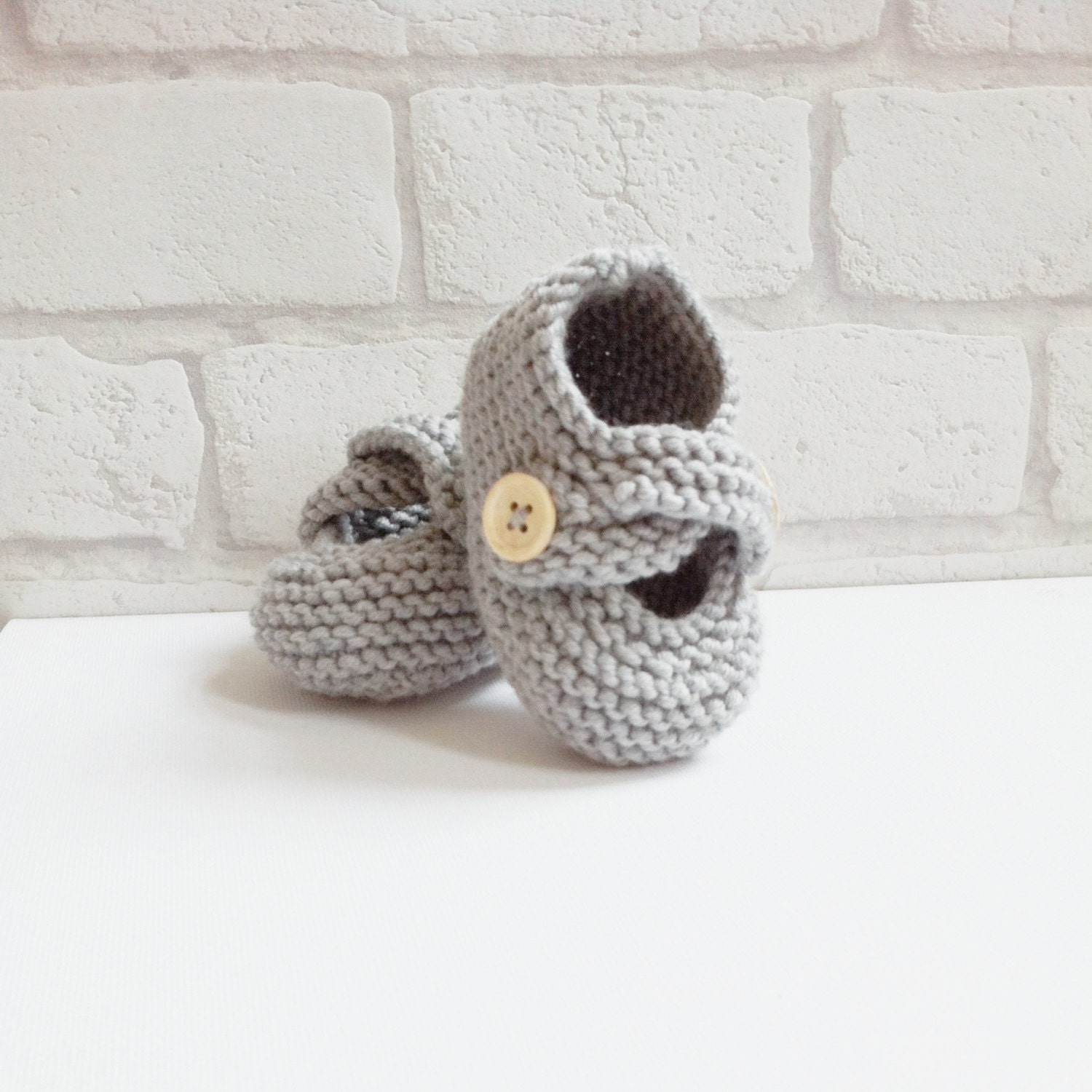 grey hand knit merino baby booties knitted baby shoes with
