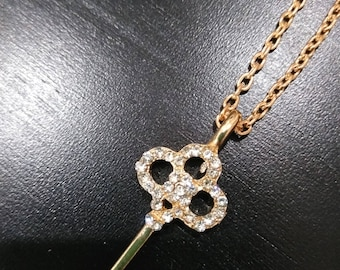 Gold key with diamond accents- adjustable