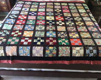 """Updated vintage quilt top.  Made from vintage squares (110) 5-/2"""" squares!  100 are 9 patch and 10 are bow ties!  Put together with black!"""