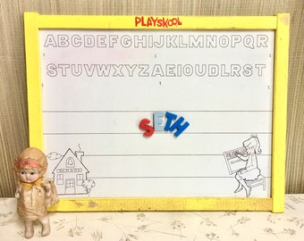 Vintage Playskool Kids White Board in yellow Frame. Reversible Magnetic Wipe and Draw Board.