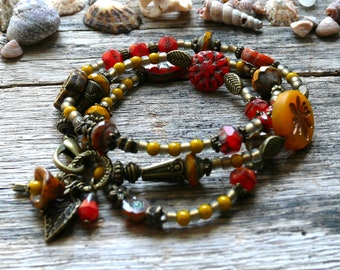 Bronze orange mustard yellow boho Bracelet/Necklace Czech glass beads 3 x wrap Bohemian gypsy bird Hummingbird curry leaf charms.