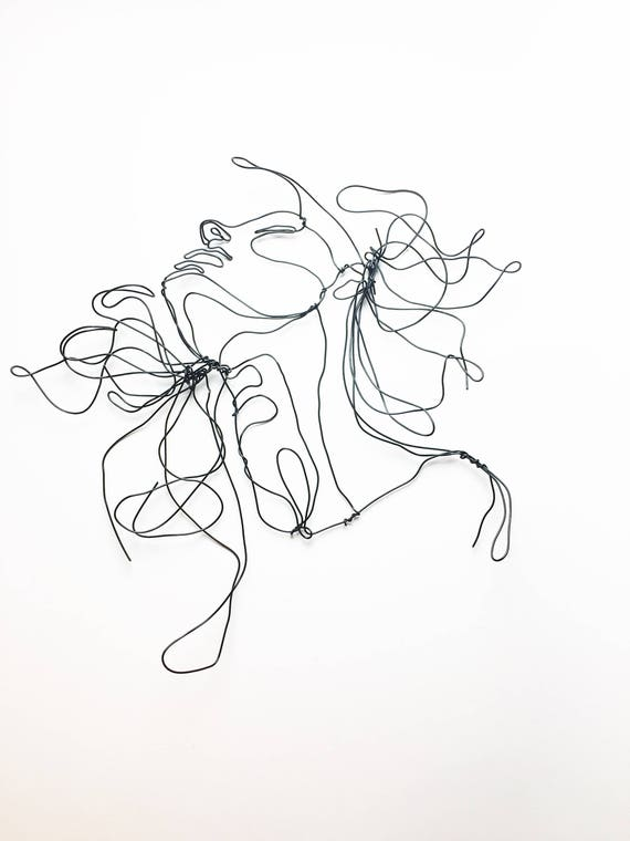 wire sculpture profile hair blowing in the wind female