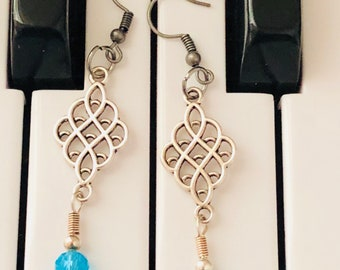 Silver Toned Dangle Earrings With Light Blue Charm