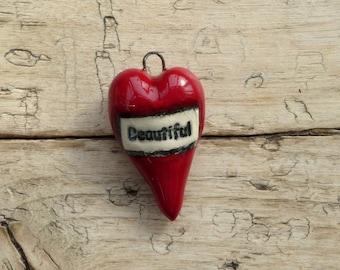 Handmade red ceramic heart 'Beautiful'