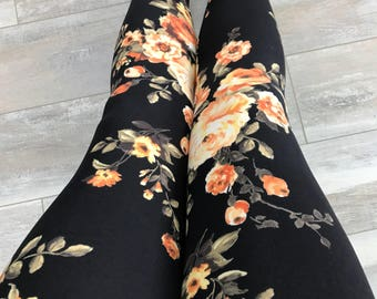 "Leggings for women, ultra comfortable in ""brushed poly"" orange and yellow flowers on black polyester/spandex"