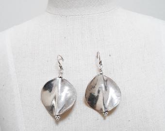 Wavy sterling silver disc earrings.