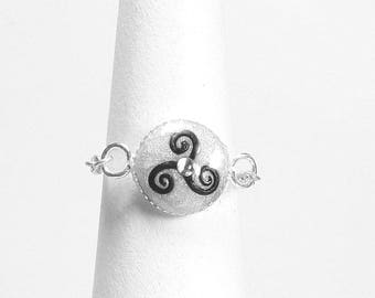 The triskele symbol chain ring