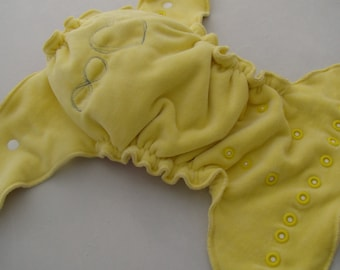 Yellow velour cloth diaper in OS size with drawn endless love sign, split diaper with inserts