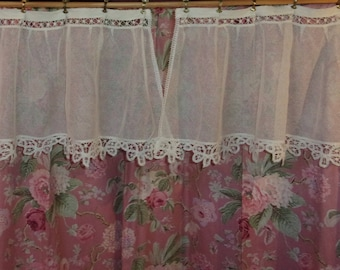 A pair of curtains made of vintage tulle with a lovely lace handmade lace
