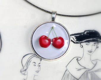Cherry necklace on a white background