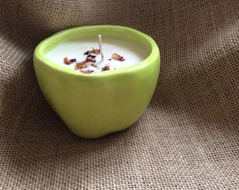 Soy wax candle in apple green ceramic container with rose petal topping