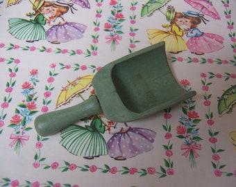 tiny green wooden scoop