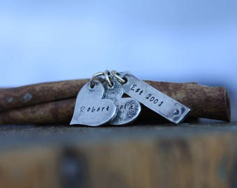 Because two people fell in Love...Eclectic hand stamped hand embossed rustic fine and sterling silver personalized mothers couples necklace