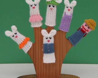 Peter Rabbit Finger Puppet Set  (Includes Peter Rabbit, Flopsy, Mopsy, Cottontail, Mama Rabbit, and Farmer McGregor.)