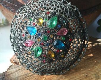 Vintage jewel tone rhinestone filigree brooch