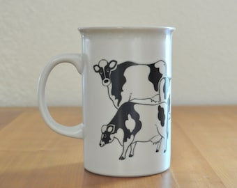 large vintage stoneware mug with cows