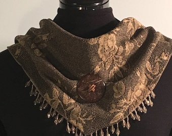 Scarf with a snap closure