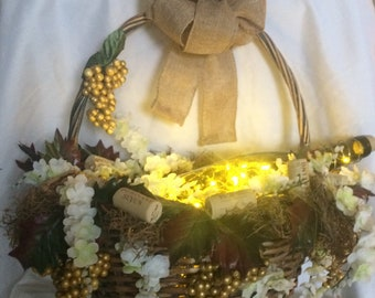 Decorated Basket with lighted wine bottle and corks