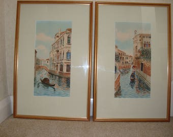 A pair of framed and mounted watercolour paintings of scenes in Venice