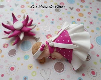 polymer clay girl baby dress with collar and bow.