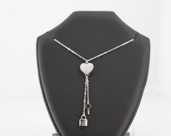 Sterling Silver Necklace Featuring Cubic Zirconia Double Pendant and Dangling Heart Charm.