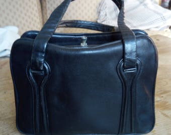 Black leather small hand bag from the 50's