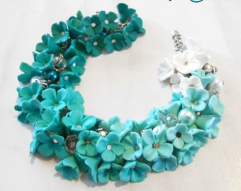 cascaded flower bracelet with fimo turquoise flowers