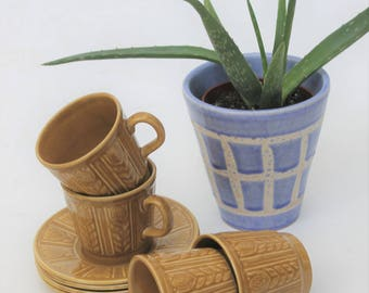 Set of Four Tams Tea Cups and Saucers