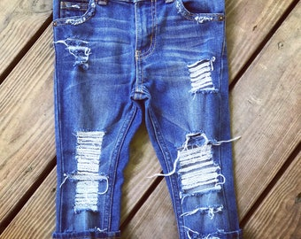 Farm girl ripped and distressed denim jeans