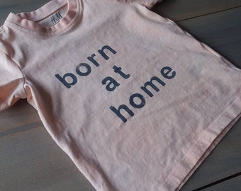 Born at home t shirt, stamped organic children's clothing, light orange color, 4-6 month