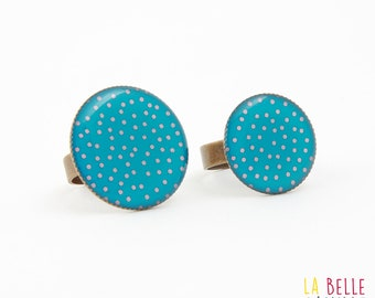 ring made of resin turquoise and coral polka dots pattern