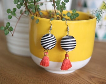 Beautiful pair of earrings graphic black and white with coral tassel.