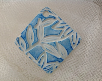 striking blue and white leaf embossed pendant tile