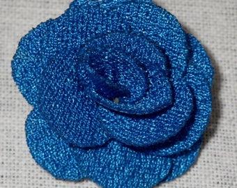 Bouton pression fleur en tissu bleu