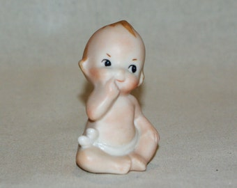 I'm a sweety-pie porcelain Kewpie doll