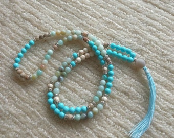 Mala in turquoise, howling, Amazonian. Diameter 6 mm