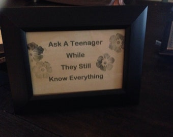 "Sign ""Ask a teenager while they still know everything..."" black frame"