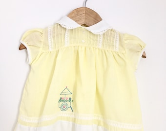Mid-century yellow dress with embroidered cart and Peter Pan collar
