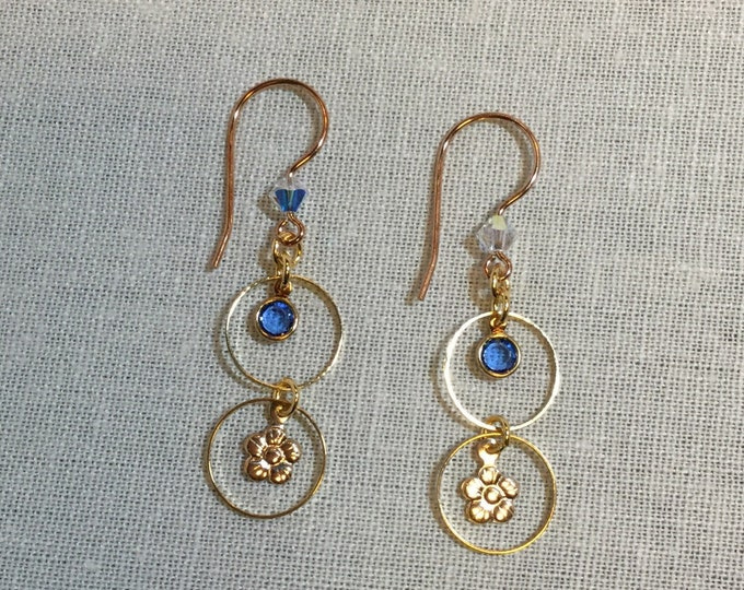 Gold hoops with flower accent