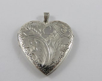 Sterling Silver  Heart Shaped  Locket With An Etched Design On Both Sides