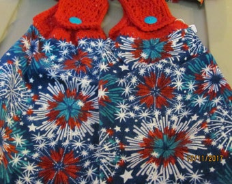 These are homemade crocheted Plush kitchen towels that has red, white and blue fireworks