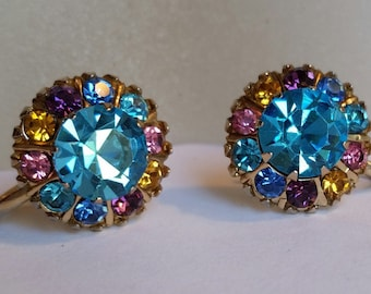 Vintage signed Coro Turquoise Blue rhinestone screwback earrings. Gold tone with Blue, Purple, Pink and Yellow accent rhinestones.