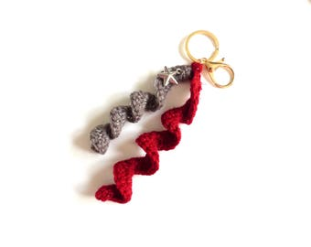 Keychain is hand crocheted red and taupe, Silver Star