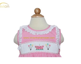 D18.60 - Birthday hand smocked dress