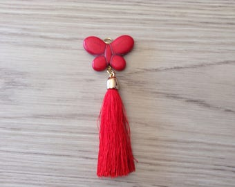Howlite and gold tassel with extendable shell Butterfly pendant