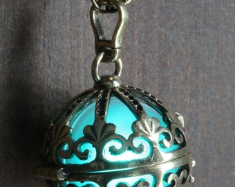 Teal Glowing Pendant Necklace Ornate orb Locket Antique Bronze, glow Jewelry