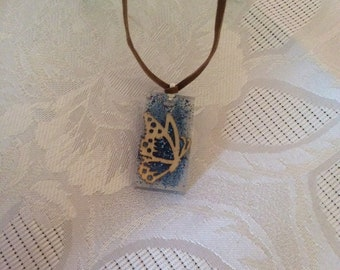 Blue pendant with butterfly